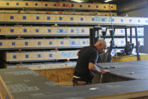 The Eden Insulation team fabricating panels for their Passivhaus frames