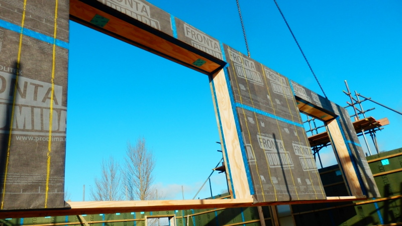 An insulated airtight panel being craned into place at 16 Stoneworks Garth by Eden Insulation