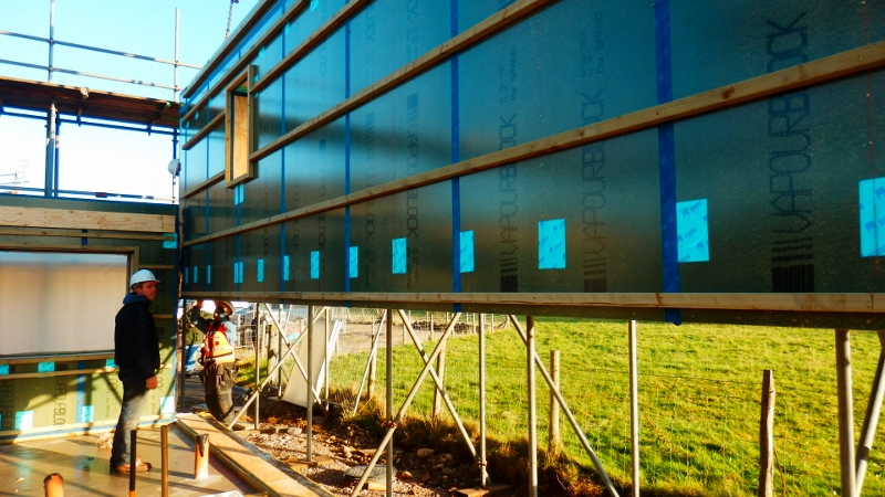 One of the insulated airtight frame panels being lifted into place at 16 Stoneworks Garth by Eden Insulation