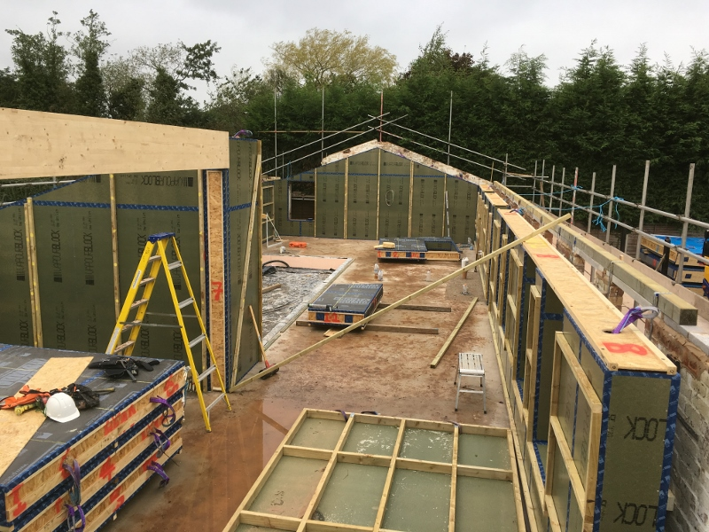 Installing a sealed insulated timber frame within the existing walls of an old farm building to achieve the Passivhaus EnerPHit standard - Eden Insulation