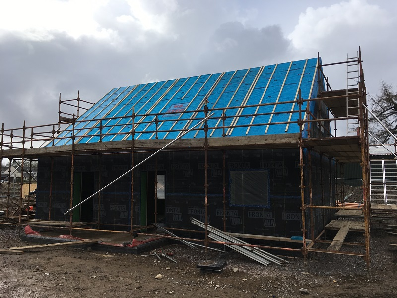 Completed timber frame north elevation at small Passivhaus in Gatehouse-of-Fleet