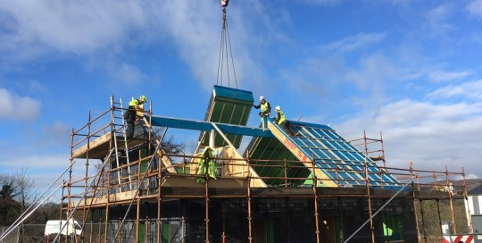 Roof panel installation at small Passivhaus in Gatehouse-of-Fleet