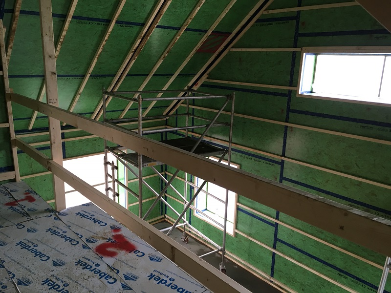Looking from mezzanine level to south facing windows at small Passivhaus in Gatehouse-of-Fleet