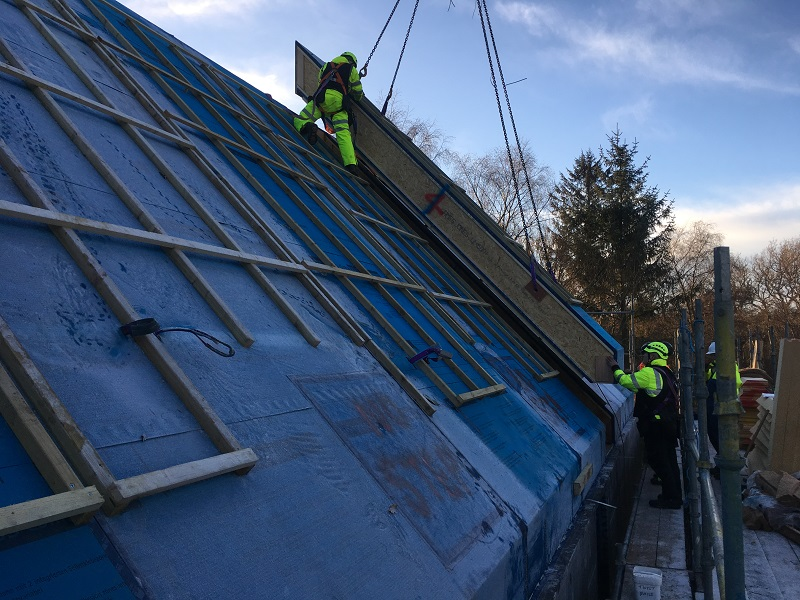 Last roof panel going into position in Durris Aberdeenshire